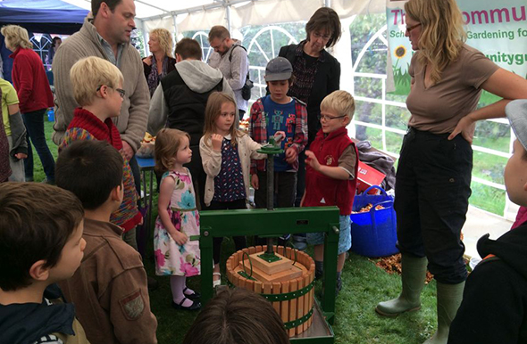 Children using an apple press
